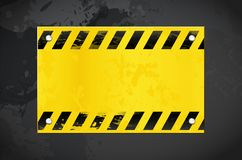 Dark grungy background and yellow warning banner with copy space royalty free stock photography