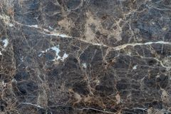 Dark grungy faded marble with veined white patterns - high quality texture / background royalty free stock images