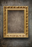 Dark, grungy wall with gold frame Royalty Free Stock Photos