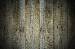 A dark grungy wooden background Royalty Free Stock Photos