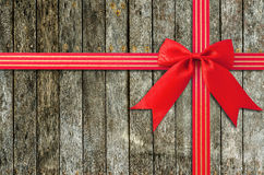 A dark grungy wooden background and red ribbon Royalty Free Stock Photo
