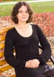 Dark hair girl in black dress Stock Images
