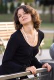 Dark hair girl in black dress Royalty Free Stock Photography