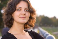 Dark hair girl in black dress. Posing outside Stock Image