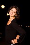 Dark hair girl in black dress Stock Image