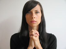 Dark hair girl praying Stock Photos