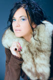 Dark hair girl, woman, model in fur Royalty Free Stock Image
