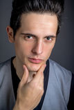 Dark Hair Green Eye Male With Hand On Chin Stock Images