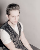 Dark Hair Green Eye Male In V-Neck And Vest Royalty Free Stock Photos