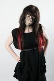Dark hair with red tips on a girl with attitude. Dark hair with red tips on a young girl wearing a black dress with attitude Royalty Free Stock Photography