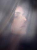 Dark hair woman. Portrait in available light Stock Photos
