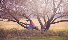 Dark Hair Woman on Tree Stock Image