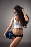 Dark-haired athlete posing with boxing gloves Royalty Free Stock Photos