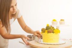 Confectioner cuts  cake Stock Photo