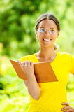 Dark-haired beautiful young woman with book Stock Photography