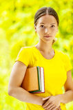 Dark-haired beautiful young woman with books Stock Photos