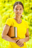 Dark-haired beautiful young woman with books Royalty Free Stock Photos