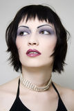 Dark haired beauty. Glamourous woman with dark hair Royalty Free Stock Photography