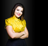 Dark haired business beauty in gold blouse Stock Image