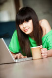 Dark-haired gir with a  computer Stock Images