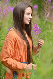 Dark-haired girl with braids and daisies Royalty Free Stock Images