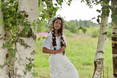 Dark-haired girl with braids and daisies Royalty Free Stock Photography
