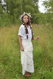 Dark-haired girl with braids and daisies Stock Image