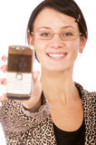 Dark-haired girl with cellular telephone Royalty Free Stock Images
