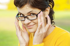Dark-haired girl in glasses Royalty Free Stock Photos