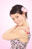 Dark-haired girl on pink background Royalty Free Stock Images