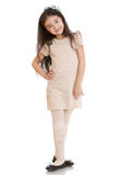 Dark haired girl posing in dress beige Stock Photography