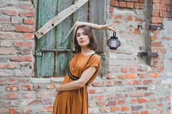 Dark-haired girl. Posing with a lantern Stock Photography
