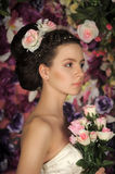 Dark-haired girl with roses Royalty Free Stock Photography