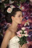 Dark-haired girl with roses Stock Photography