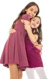 Dark-haired girl sisters in fashionable dresses Stock Image