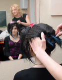 Dark-haired girl to do a coiffure in a hairdressing salon Stock Photography