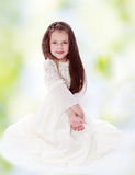 Dark-haired girl in a white dress. Royalty Free Stock Image