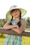 Dark-haired girl in a wicker hat Royalty Free Stock Photos