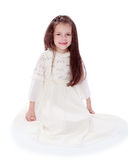 Dark-haired little girl in a white dress Stock Images