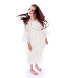 Dark-haired little girl in a white dress Royalty Free Stock Photo