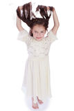 Dark-haired little girl in a white dress Royalty Free Stock Photos