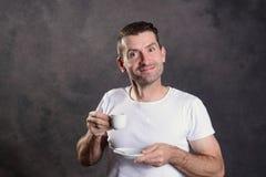 Dark haired man drinking espresso Royalty Free Stock Photos