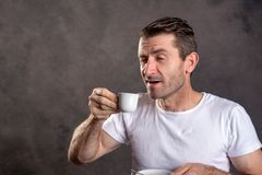 Dark haired man drinking espresso royalty free stock photos
