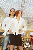 Dark-haired man embrace red-haired woman from behind Stock Image