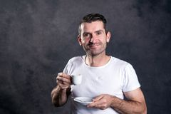Dark haired man with espresso cup stock image
