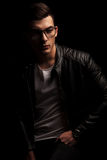 Dark haired man in leather wearing frames, resting Royalty Free Stock Photo