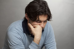 Dark-haired man lonely Royalty Free Stock Photos
