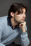 Dark-haired man thinking Royalty Free Stock Images