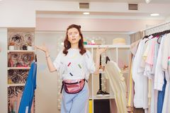 Dark-haired shopaholic feeling emotional in new shopping mall. Emotional shopaholic. Dark-haired shopaholic feeling emotional in new shopping mall while seeing Royalty Free Stock Photography