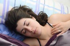 Dark haired sleeping girl. Royalty Free Stock Photo